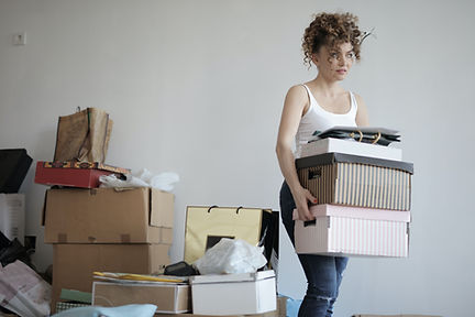 concentrated woman carrying stack of boxes. Klutter Kutters Santa Barbara Clutter Cutters Moving Clients Move Managers Professional Organizer Senior Move Manager Move Manager Need Help Moving
