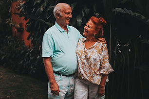 An elderly couple holding each other and smiling at each other. Klutter Kutters Santa Barbara Clutter Cutters Moving Clients Move Managers Professional Organizer Senior Move Manager Move Manager Need Help Moving