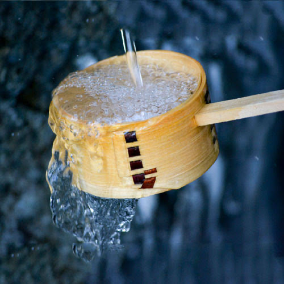 Hokkaido Sake - Known to be light, crisp & dry being poured over a sake bowl