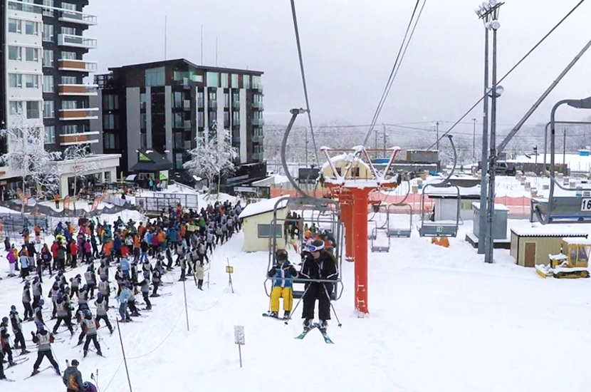 People Queuing Crowded Busy Lift Lines at Niseko Ski Resort