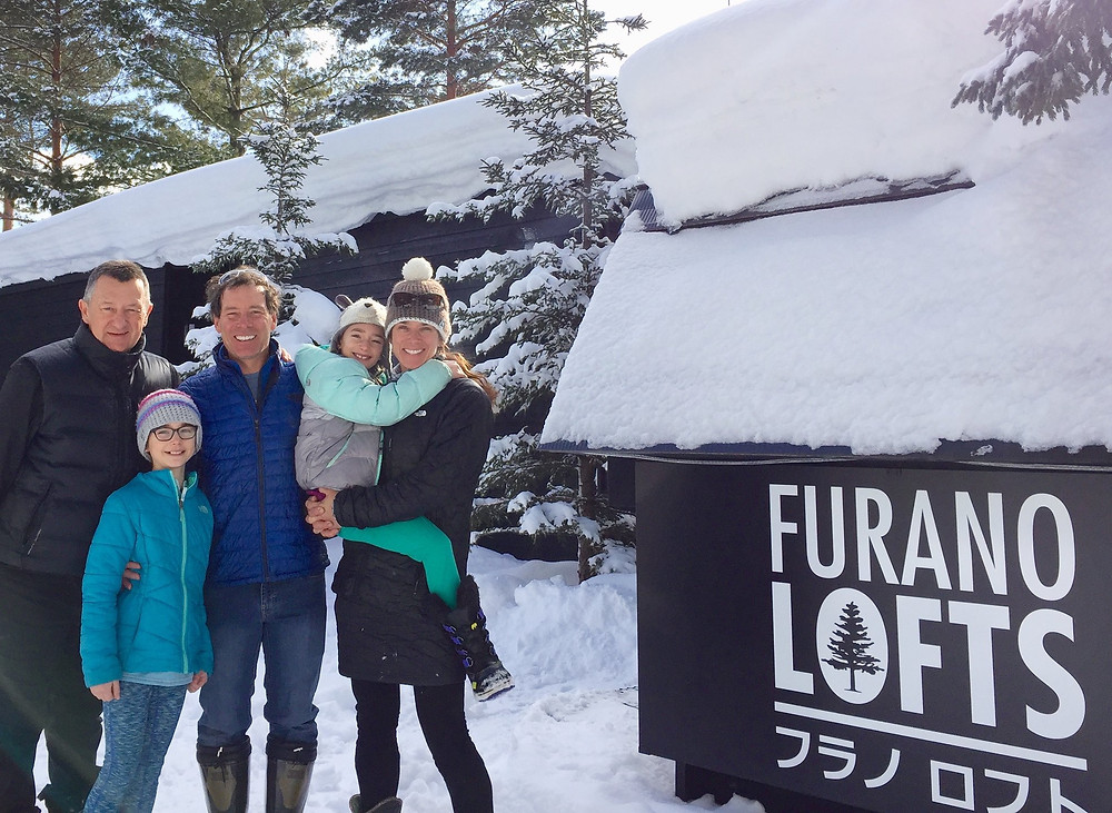 A family standing with Furano Lofts owner Leon Flint, at Furano Lofts property in Furano Japan
