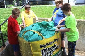 Students from 5th Grade moving soil to t