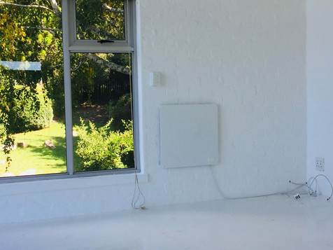 BEFORE: A bare white room with nothing in it but a solar heater...