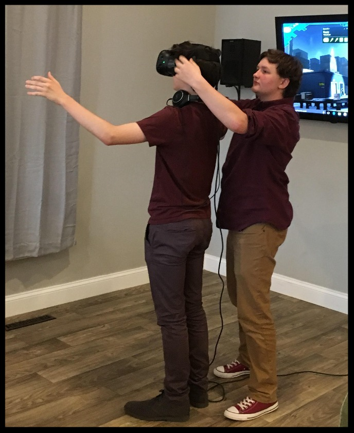 Tucker demonstrating the VR at EWoW.