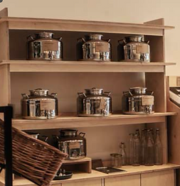 Image of silver containers on a shelf