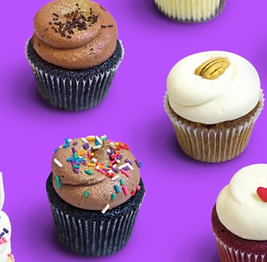 Image of chocolate cupcakes on a purple background