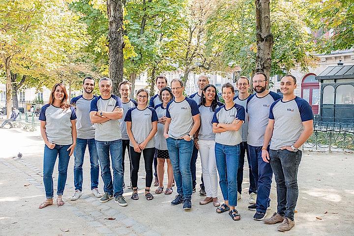 Tilkal team in a garden in Paris dressed with Tilkal branded tee-shirts