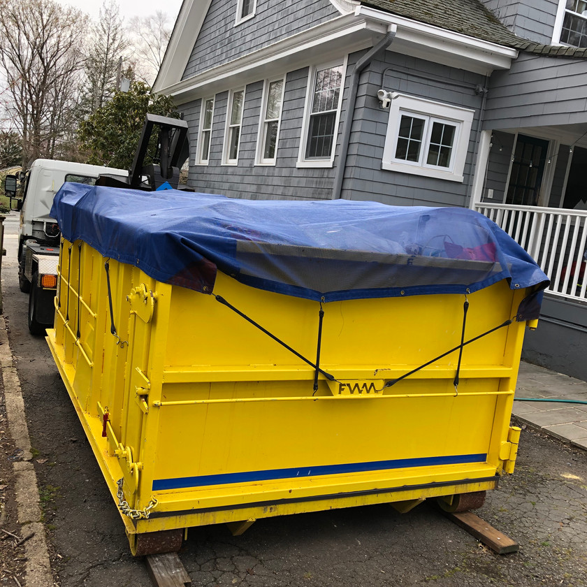 A customer disposed of items from the garage, basement, attic and yard in a Prendeville Disposal container.