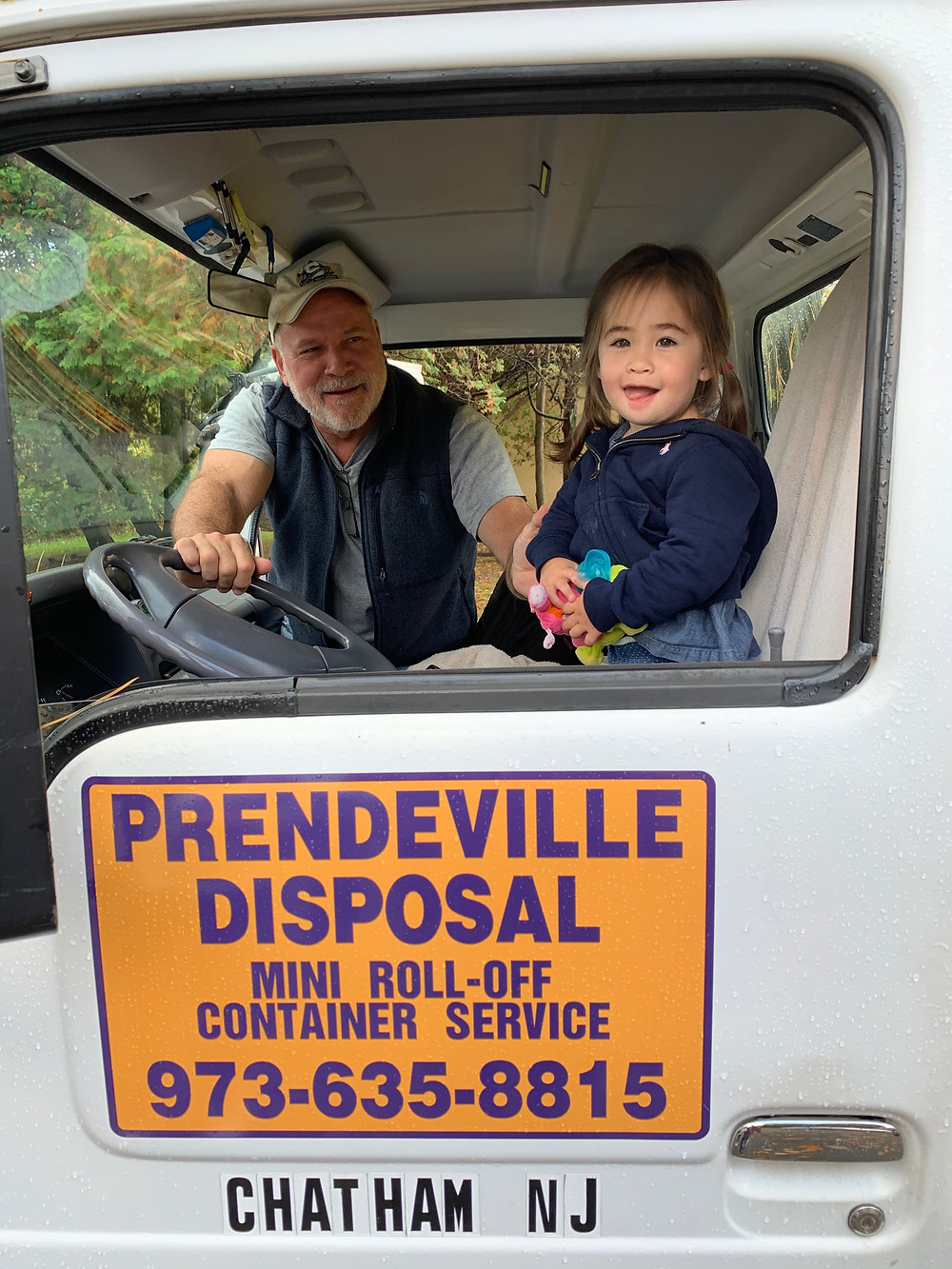Sweet girl in a Prendeville Disposal truck in Morristown.