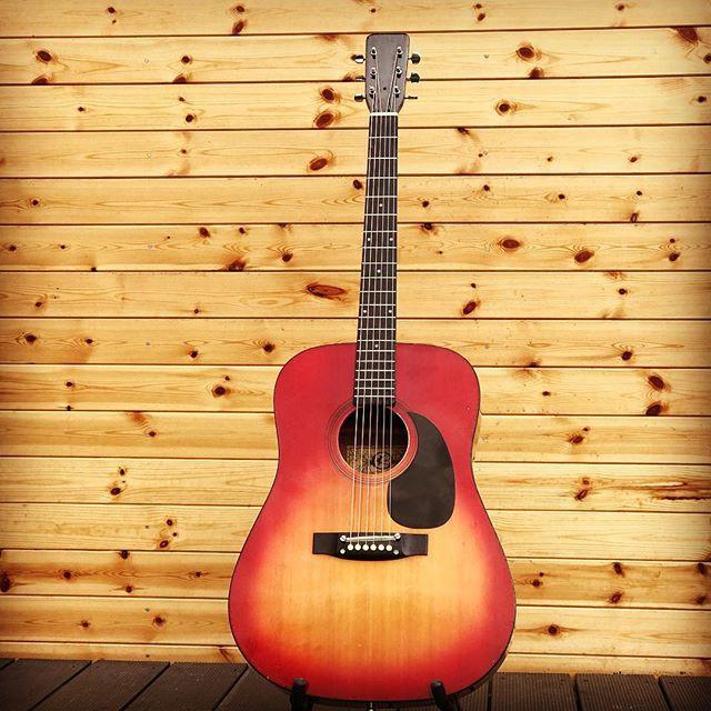 an old redburst Kay acoustic guitar after sympathetic repair refurbishment set up and restoration at Malone Guitars workshop in Billericay Essex