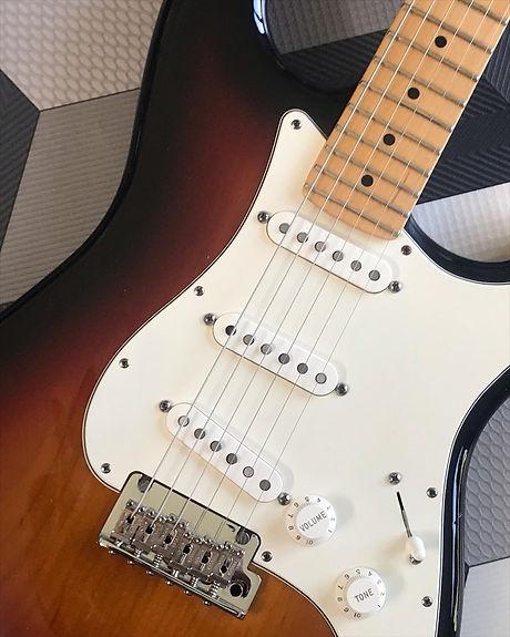 fender stratocaster guitar set up in the malone guitars workshop in essex