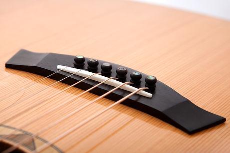 Malone Guitars ebony hand made acoustic guitar bridge and bone saddle