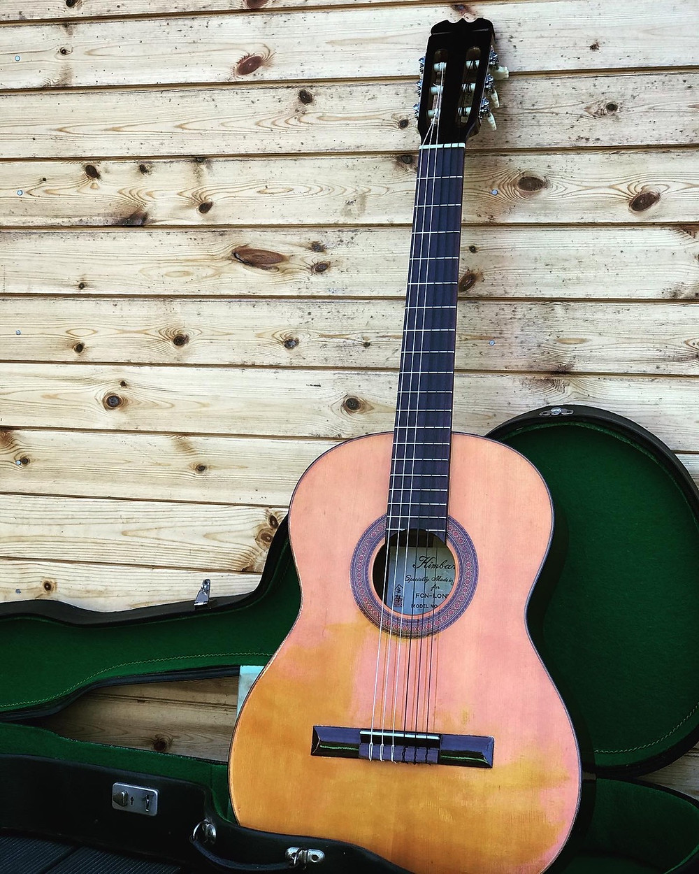 a 70s Japanese made Kimbara classical guitar in its case after a bridge repair and set up at Malone Guitars in Billericay Essex