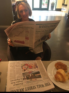 Breda reading the paper.png
