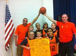 Zach and basketball team bald.jpg