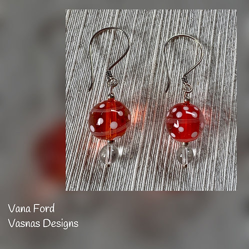 White dots on orange and silver earrings