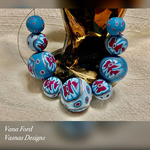 Set of nine hand formed polymer clay beads