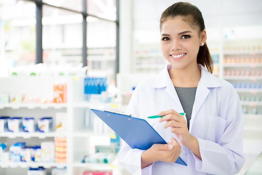Smiling Asian female pharmacist working