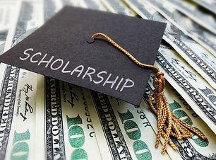 Scholarship graduation cap on money