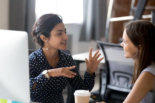 Friendly female colleagues having good r