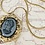 Thumbnail: Vintage Charcoal Gray Glass Cameo Ornate Frame Necklace
