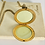 Thumbnail: Vintage Filigree Brass Flower Two Picture Locket
