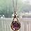 Thumbnail: Vintage Purple Avon Reverse Carved Glass Necklace