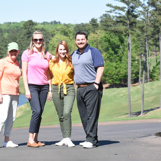 Members of the AEW team at a charity golf event
