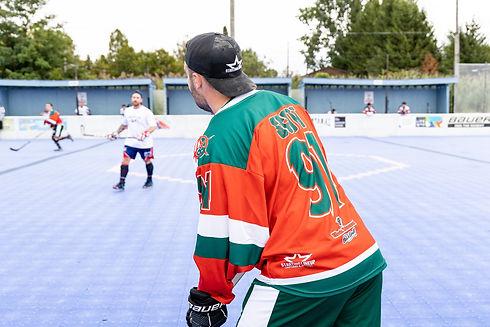 Athlete wearing an orange and green jersey