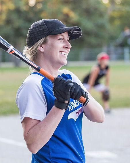Girl athlete playing baseball