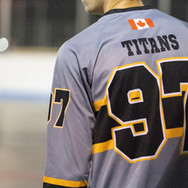 Athlete in a gray and yellow jersey