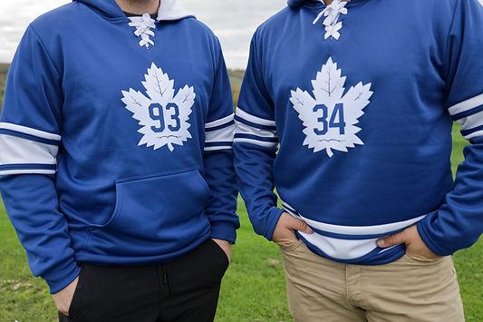 2 men wearing blue jacket