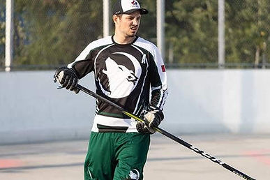 Athlete playing ball hockey