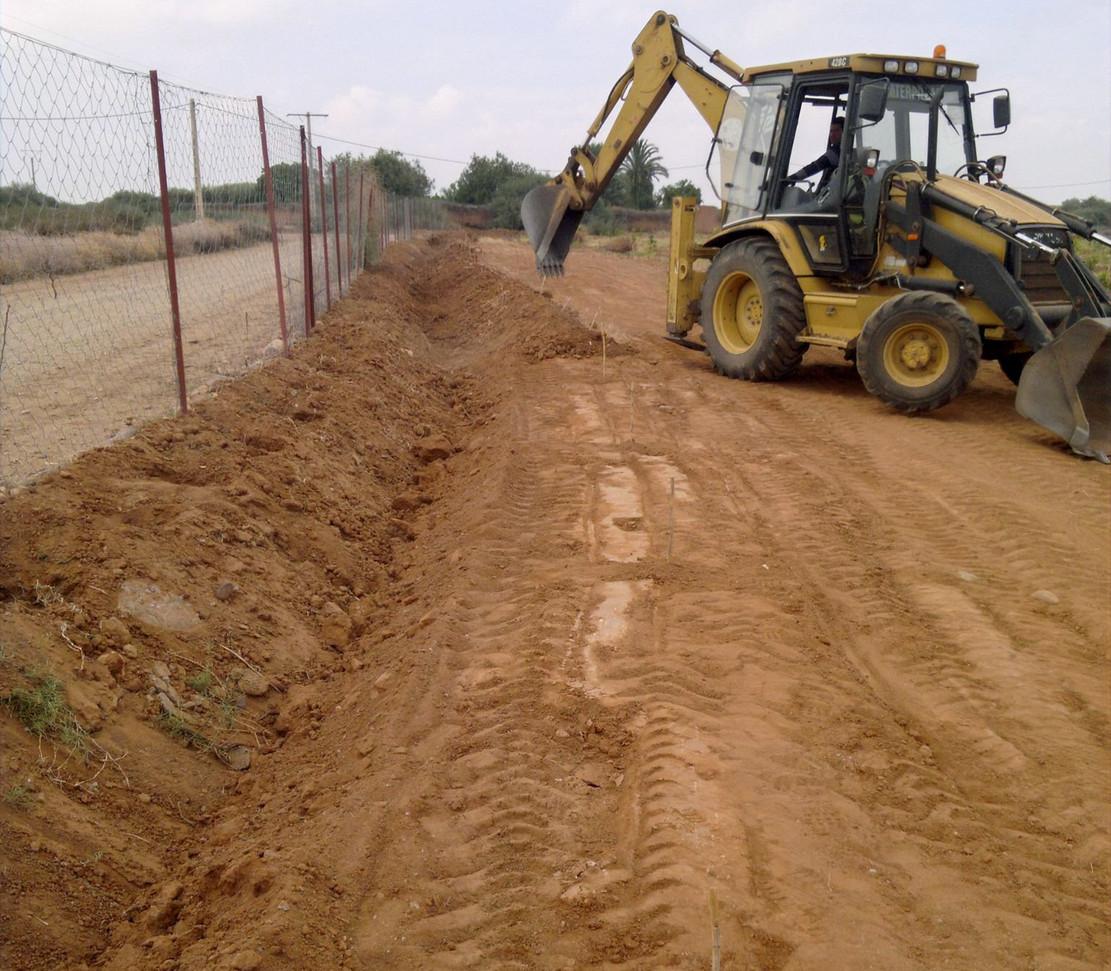 Création d'un drain d'évacuation des eaux de pluie contre les innondations...