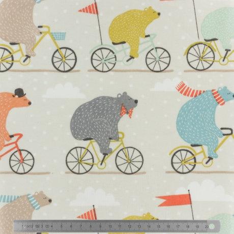Toile cirée Ours sur vélo multicolore fond beige clair 25€/m
