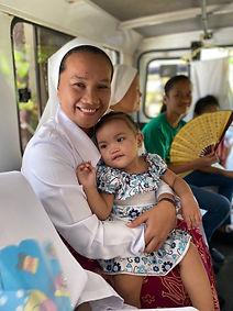 Mission Life Sr. Nida with baby Kate.jpg