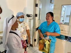 SSv Sr. Ruby talking with maternity nurs