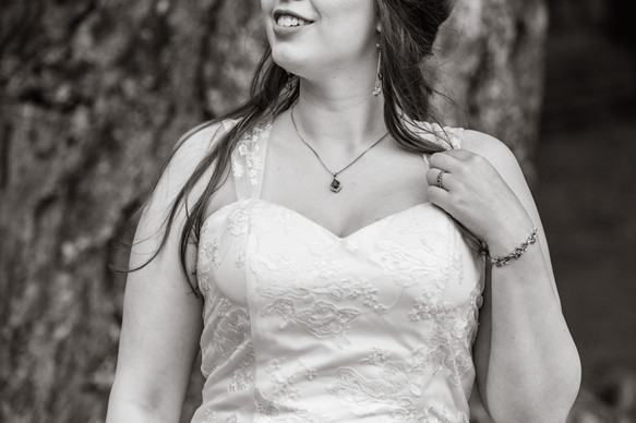 Black and white photo of the bride showing jewelry details