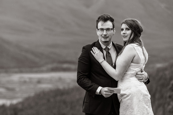 Black and white photo of bride and groom overlooking Banff National Park.