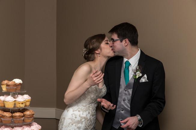 Calgary Char Bar Wedding Reception, Bride and Groom Cut Cake