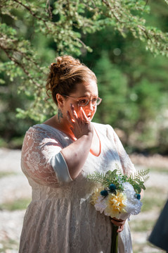 Bride wiping away a tear at the ceremony.