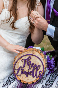 Bride and groom displaying the new last name they are both taking at Cascade ponds.