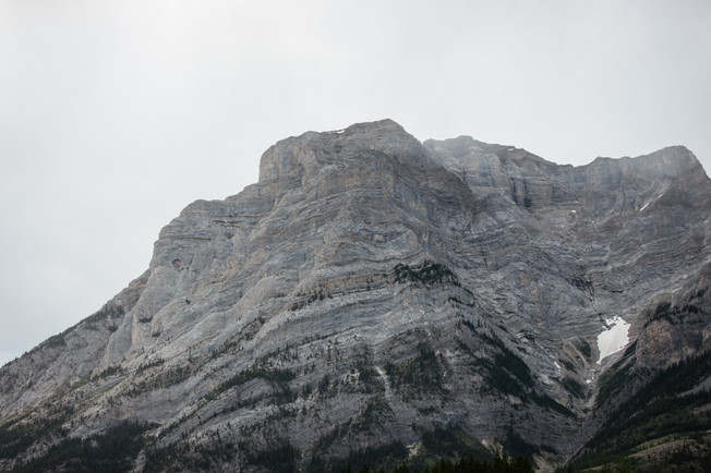 Looking up at a mountain to the sky in Kananaskis.
