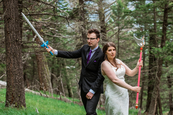 Bride and groom holding swords props