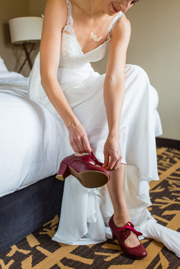 Banff National Park, Bride putting red shoes on