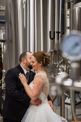 Bride and groom at a distillery, Calgary Wedding Photographer