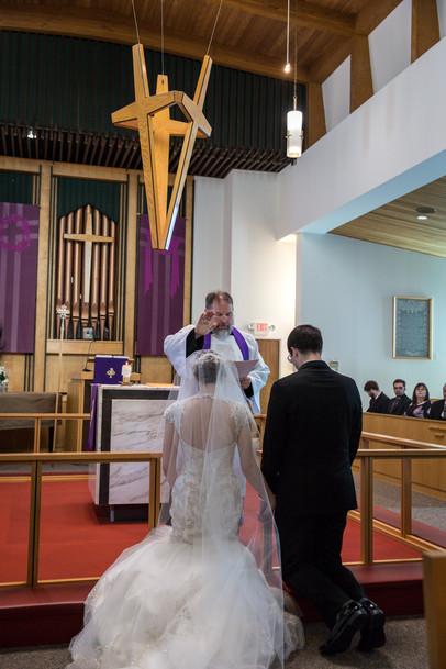 Highwood Lutheran Church Wedding, bride and groom pray