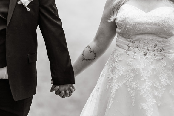 bride and groom, holding hands, back and white