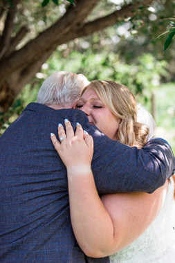 Emotional moment of the bride hugging her Father during the first look.