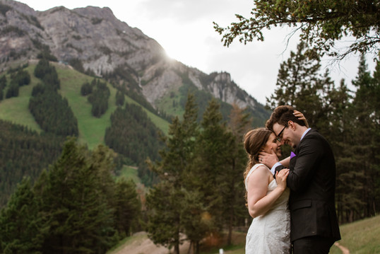 Bride and groom embracing with a beautiful scenery behind them